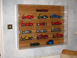 Model cars in acrylic wall case